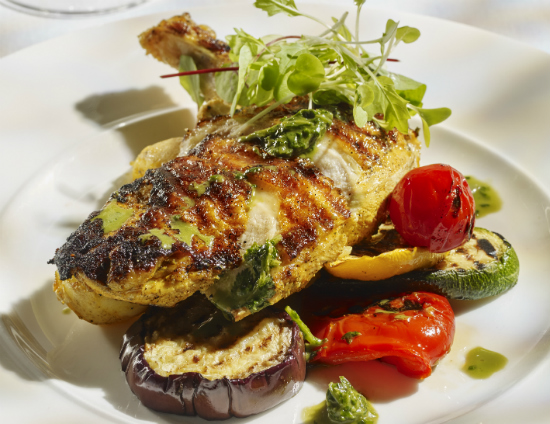 chargrilled chicken on a bed of grilled vegetables
